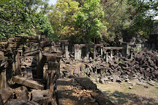 Most of the temple is in ruins from trees and landmines