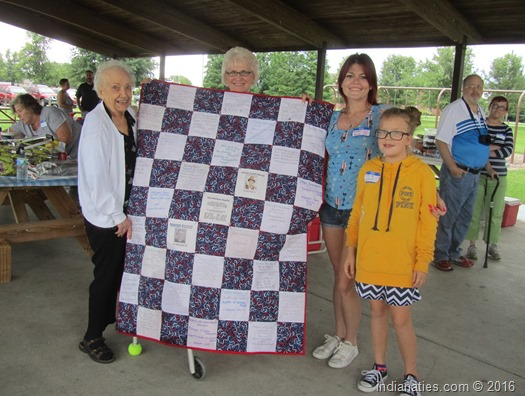 Peg Stull, Marti Fleetwood put their sewing talents to work on this very nice quilt.  Misty Buis and her daughter were excited to win the raffle.