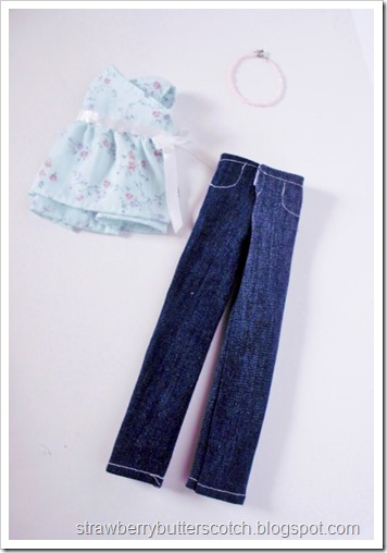 Cute new doll outfit.  Jeans, wrap top, and a necklace.
