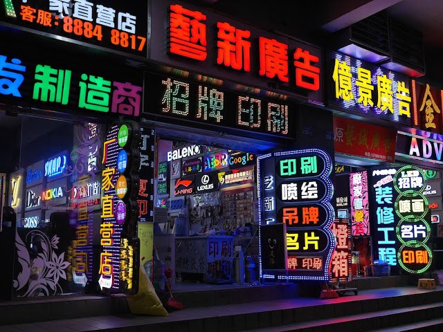 numerous neon signs at shops
