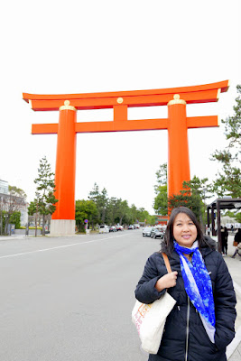 the massive Torii gates of Heian Jingu, or Heian Shrine in Kyoto - it's the largest Torii Gate in Japan. Built in 1929, it is 24.2 meters high; the top rail is 33.9 meters long