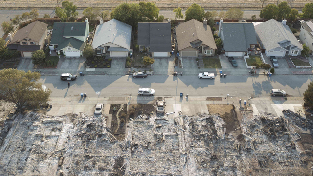 On some streets in Coffey Park, California, homes on one side were incinerated by the Santa Rosa wildfires, while those on the other side appeared untouched. Photo: Derek Watkins / The New York Times