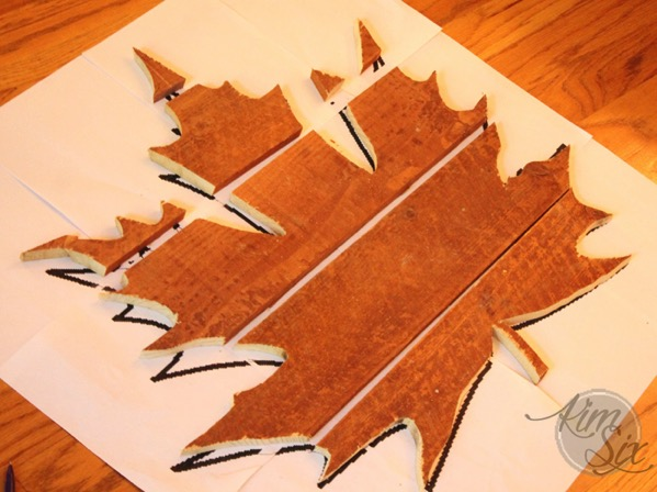 Laying out wooden leaf silhouette