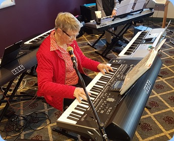 Jeanette Harding playing and singing with her Korg Pa3X.