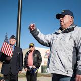 Ron Toomer, right, speaks before the flag-raising at Hamilton's new Veterans Monument Friday. Toomer is the former commander of American Legion Post #94. Photo by Ian Keffler.