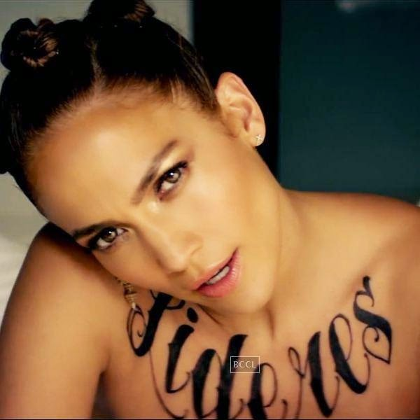 "Jennifer Lopez exposed her fake tattoos in the ""Follow the Leader,"" music video."