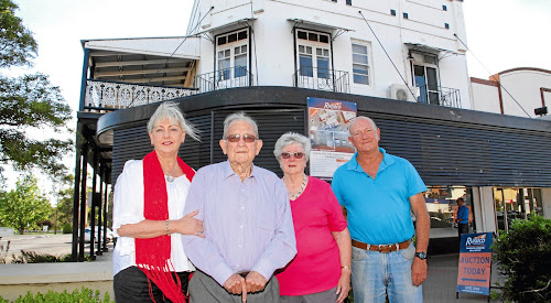 Previous owners of the iconic building, John and Pam Goodyer with their daughter Jayne Hayne and son Michael Goodyer outside the historic Krohn's building.