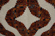 Detail of a Curved Log Cabin quilt by Audrey Woods with the quilting pattern Rambling Hearts