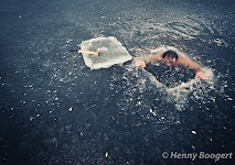 Wim Hof submerged in an ice hole.