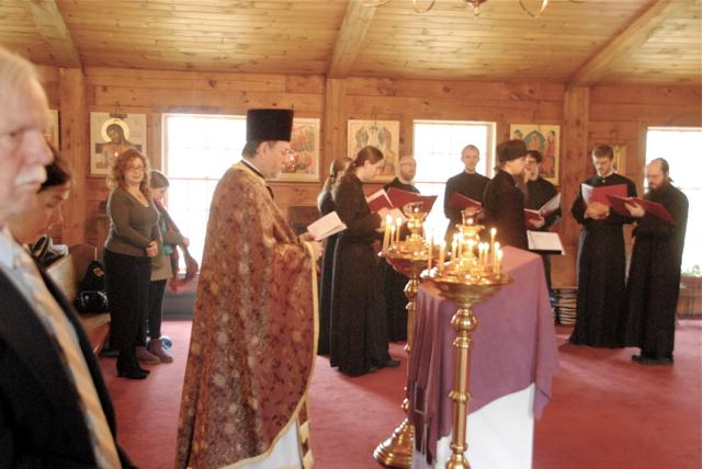 Fr. Chad prays following Communion.