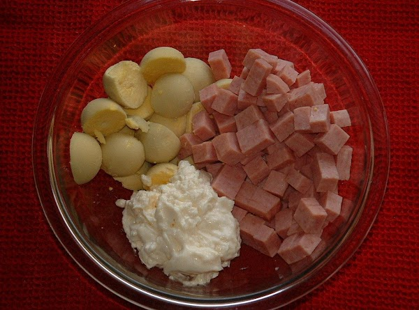 To the bowl with the yolks, add the Spam cubes and mayonnaise. With the...