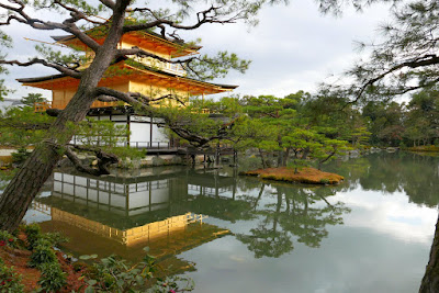 At Kinkakuji Temple, the trees and stones have unusual shapes as the garden is designed to provide a view of different scenes while walking around this Mirror Pond.
