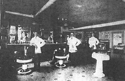 @ 1912 inside of barbershop located below what is now Dohman Electronics (2012). Barbers: Fuzzy Turner , Eddie Cooney, Babe Frobish.  Plaindealer photo 1976. Original belonged to J. H. Carson.