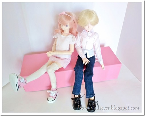 Usagi and Yuki sitting and admiring their new shoes and clothes.