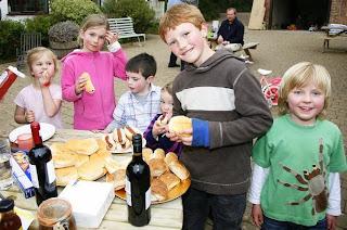 Kids enjoying a BBQ in the courtyard