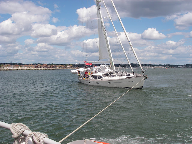 31 May 2011 - The Mersey class ALB tows the yacht