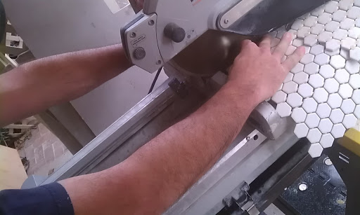 Unlike a standard saw you can get a lot closer to a tile saw blade. I will sometimes work directly with it, just watch the blade edge, that is where the action is.