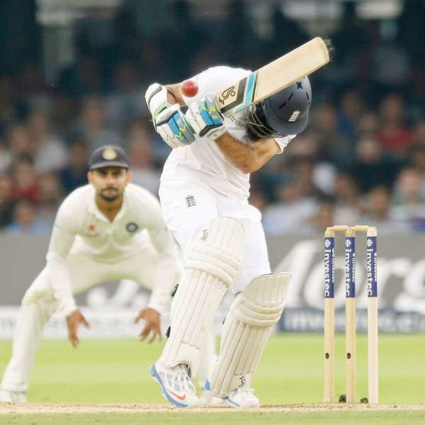 England's Moeen Ali ducks as he hits a shot that was caught out by India's Cheteshwar Pujara off an Ishant Sharma delivery on the fifth day of the second cricket test match between England and India at Lord's cricket ground in London, Monday, July 21, 2014.
