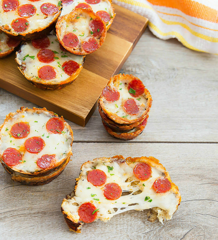overhead photo of stacks of Cauliflower Pizza Muffins