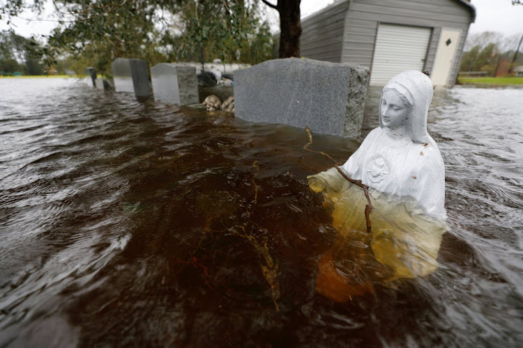 A Christian statuette submerged in rising flood waters in the aftermath of Hurricane Florence.