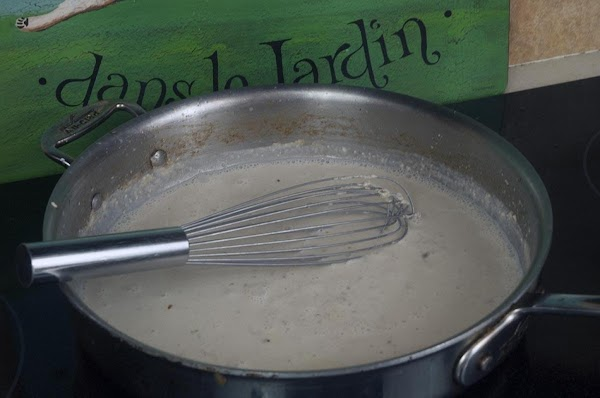 Add the milk, about a 1/4-cup at a time, and whisk until each addition...