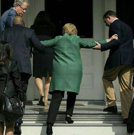 Hillary-Clinton-Helped-Up-Steps