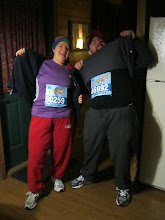 Photo: Saturday morning, at like 3:30 AM.  The runners pose for a picture before they catch a bus to the starting line.  They are wearing outer layers that Cathy had bought at a thrift store, so that they could be tossed into donation piles during the race.
