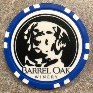 Poker chip bearing a dog image used for beer discounts