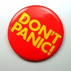 Don't Panic Button: yellow on orange