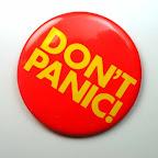 Don't Panic Button: yellow on orange