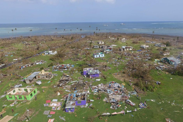 Aerial view of houses destroyed by Cyclone Winston on Fiji's Koro Island, 24 Feburary 2016. Photo: Brant Cumming / ABC News