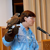 Jeanne Wadsworth shows the students the broad-winged hawk.