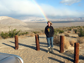 Mary on top of Egg Mountain being zapped by a rainbow.