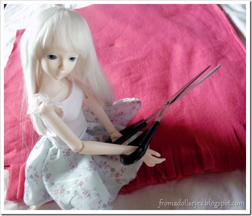 Ball Jointed Doll Posing with Scissors