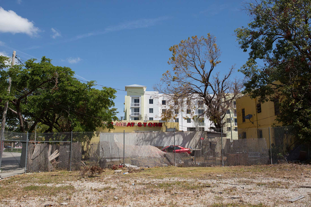 A new development is seen behind an abandoned lot in Miami. Photo: Alicia Vera / Bloomberg