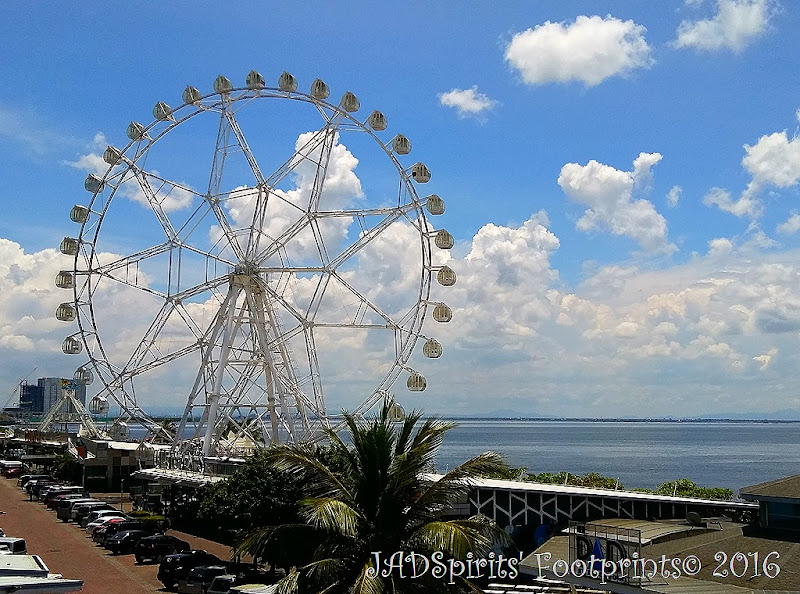 The MOA Eya and the Manila Bay in the background