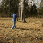 Bobby Graves rolls up the electric fence that ran along the top of the cemetery fence.  This was used to keep out the cattle that grazed in this area at one time.  This will not be replaced since the area is now a subdivision.