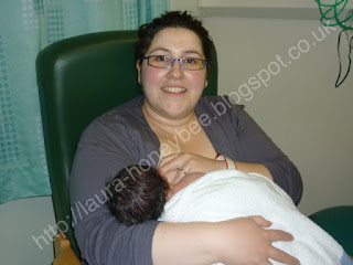 Mother breastfeeding newborn