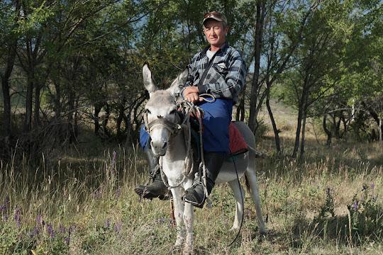 Bauer auf seinem Esel