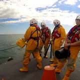 ALB crew members practise firing the rocket line on a training exercise - 8 June 2014.  Photo credit: Dave Riley/RNLI Poole