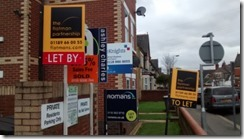 Letting agent boards in Newtown s