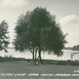 Sylvan Lake near Keego Harbor Michigan Image of picnic table, swing and lounge chairs on grass near the lake L-2061