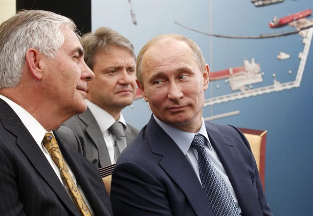 A file picture dated 15 June 2012 shows Russian President Vladimir Putin (R), Krasnodar region Governor Alexander Tkachev (C) and ExxonMobil Chairman and CEO Rex Tillerson (L). Photo: Mikhail Klimentyev / RIA NOVOSTI / EPA