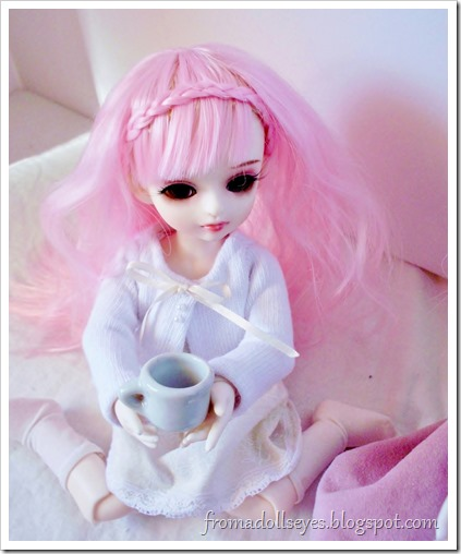 A cute ball jointed doll having tea.