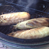 Corn is roasting over indirect heat