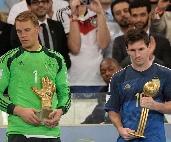Germany's goalkeeper Manuel Neuer (L) and Argentina's forward and captain Lionel Messi (R) hold their respective trophies of 'Golden Glove' and 'Golden Ball' during a presentation ceremony after the final football match between Germany and Argentina for the FIFA World Cup at The Maracana Stadium in Rio de Janeiro on July 13, 2014.