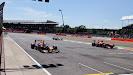 Fernando Alonso passes Sebastian Vettel's broken F1 car