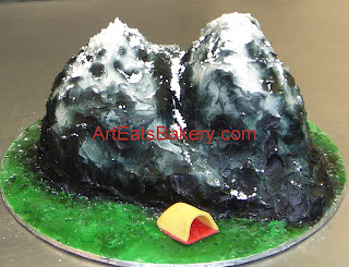 Custom 3D mountain with snow Groom's cake and fondant tent