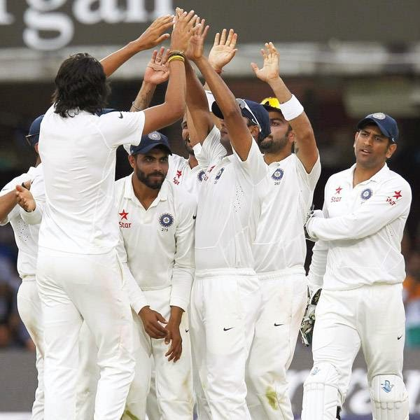 India's Ishant Sharma (L) celebrates with teammates bowling England's Ian Bell for 1 run during play on the fourth day of the second cricket Test match between England and India at Lord's cricket ground in London on July 20, 2014.