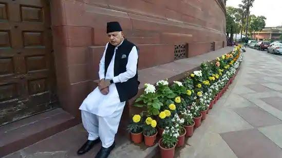 Farooq Abdullah Sitting Outside near flowers
